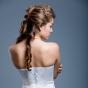 Fryzury - włosy zebrane z tyłu, z lokami