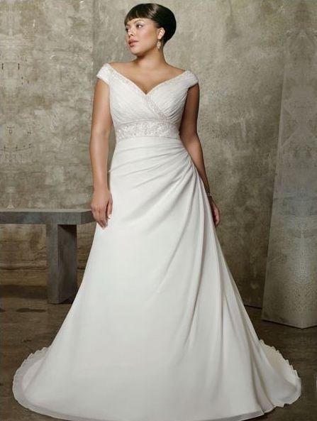 Suknia ślubna z dekoltem dla Panny Młodej o dużym biuście